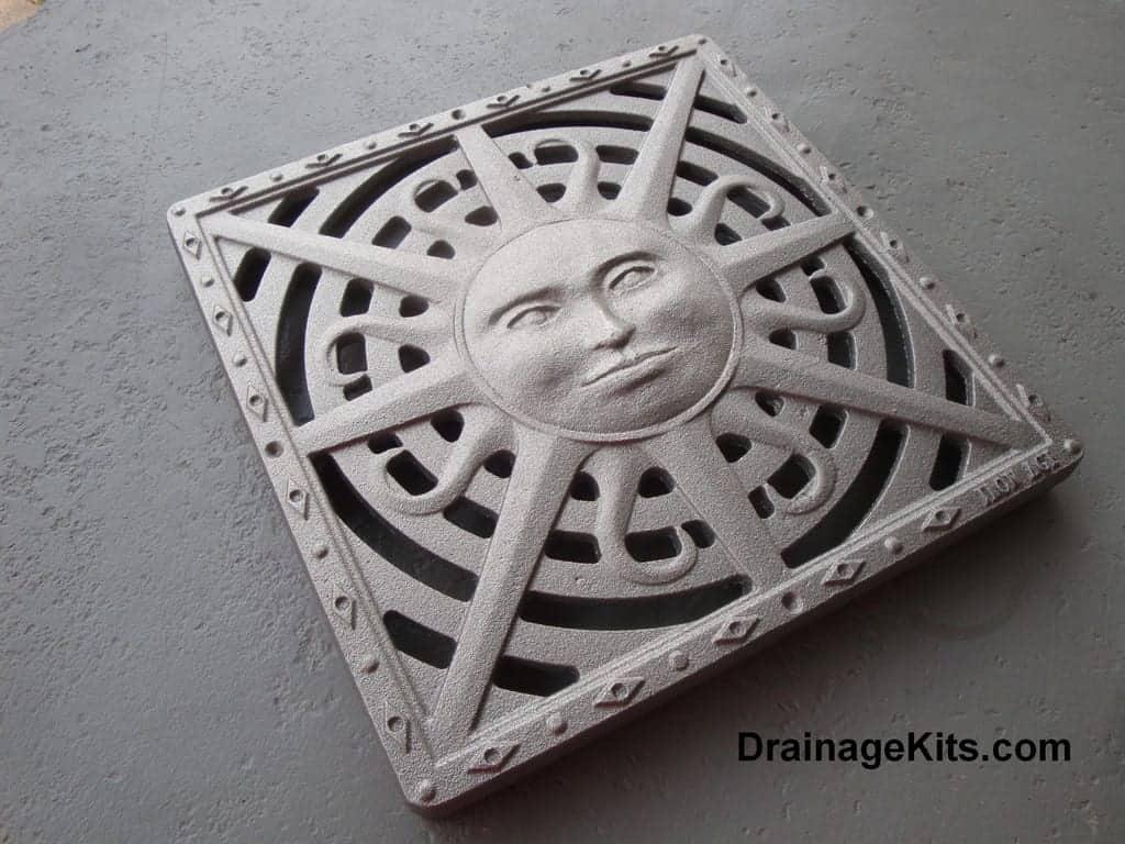 Iron Age cast iron catch basin grate / stepping stone - Sun pattern